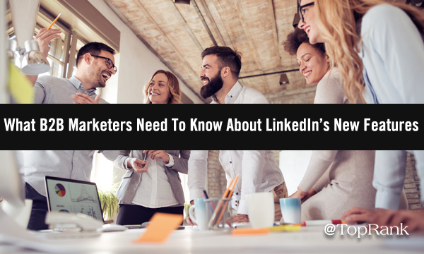 Group of B2B marketers around a table planning uses for new LinkedIn features image.
