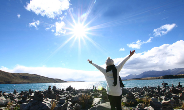 Woman with outstretched arms on a clear day image.