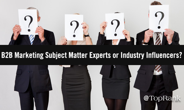 Four businesspeople holding question mark signs over their faces image.