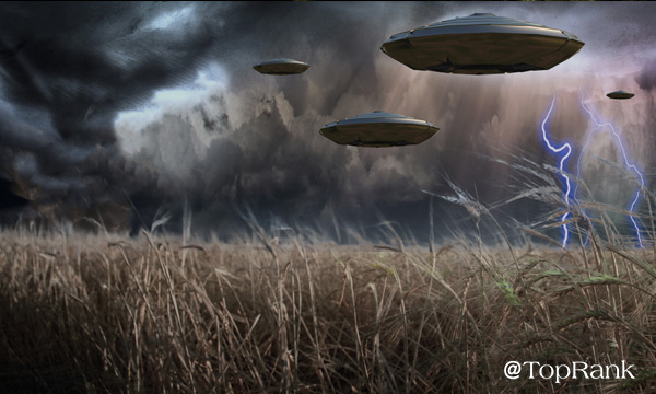UFOs over field of grass image.