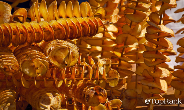 Spiral potatoes on a stick image.